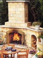 The large fireplace provides a focal point for the outdoor room and makes outdoor kitchen is built with Italian terra-cotta pavers.