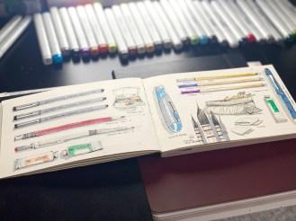 Sketchbook over desk with work tool sketches