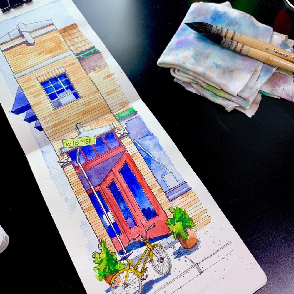 Moleskine Sketchbook with mop brushes. Brick building Con Gore watercolor sketch