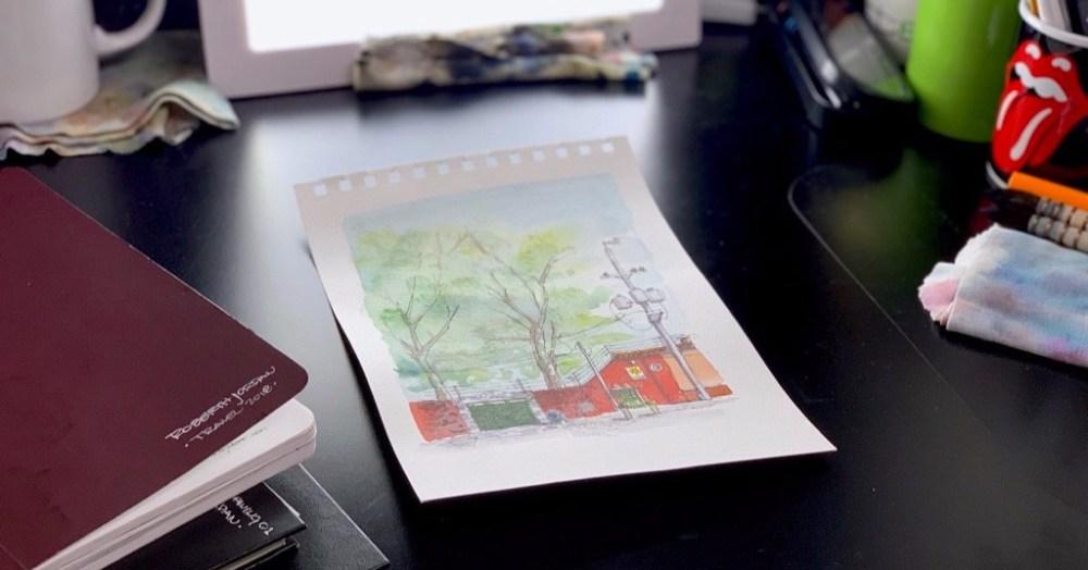 Solar Bistró Urbansketch- Sketchbook on desk showing watercolor sketch