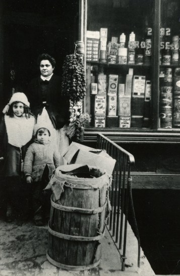 My grandmother with my aunt and uncle at her grocery store on Mott Street