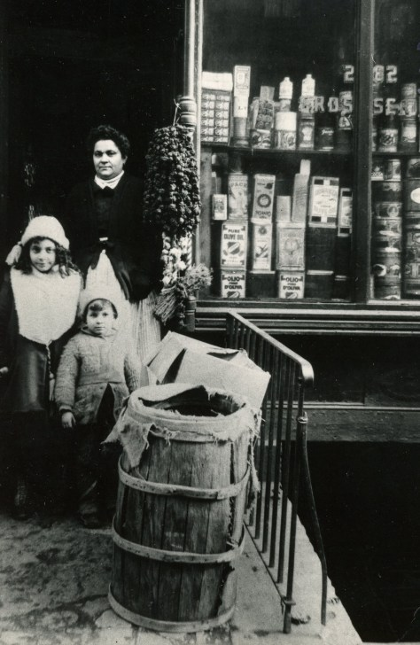 Grandma with my aunt and uncle at her grocery store on Mott Street