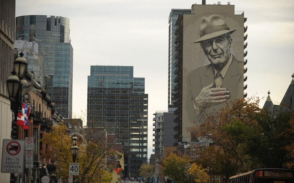 A mural of musician Leonard Cohen seen on a building in downtown Montreal, November 7, 2017. (AFP/Marc Braibant)