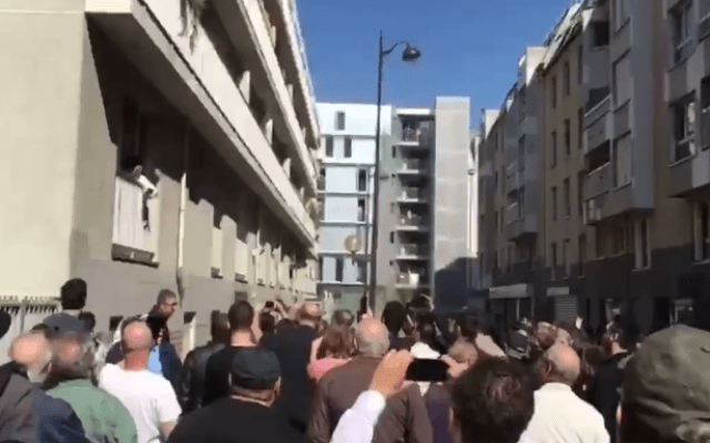 Some 1,000 members of France's Jewish community gathered outside the home of Sarah Halimi in Paris to commemorate her alleged anti-Semitic murder, April 9, 2017. (Screen capture: 0404 Video)