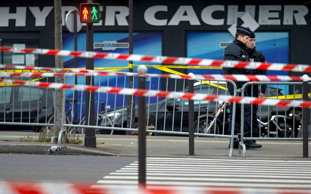Illustrative: Two French security officers standing guard on Saturday, January 10, 2015, the day after a terror attack on a kosher market in Paris. (photo credit: AP Photo/Peter Dejong)