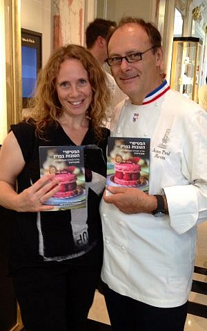 Sharon Heinrich holding copies of her book with with top French chocolate manufacturer Jean Paul Hevin. (Gali Hadari)