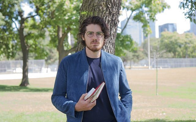 Film director Daniel Roher takes a break from putting the finishing touches on his new documentary, 'Once Were Brothers,' in a Toronto, Ontario park on August 29, 2019. (Etye Sarner)