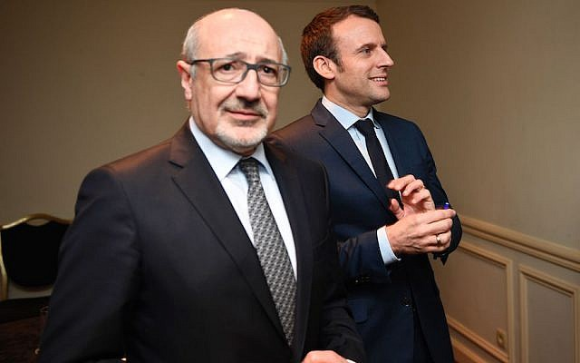 The president of the French Jewish group CRIF, Francis Kalifat, left, with presidential candidate Emmanuel Macron at the Grand Hotel Intercontinental in Paris, March 22, 2017. (Eric Feferberg/AFP/Getty Images)