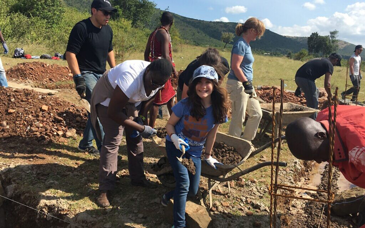 Hannah Alper helps build a new high school in Kenya as part of a service trip with the organization Me to We, in June 2016.