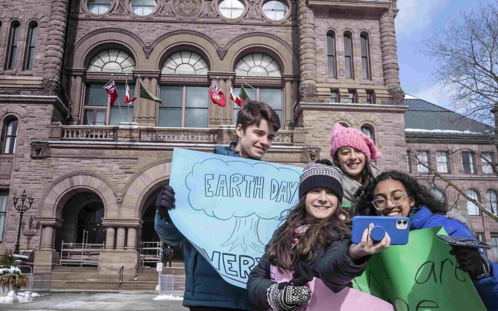 Hannah Alper, front row left, stands in front of the Ontario Legislative Building in Toronto during filming for the 'Citizen Kid' television program, February 2020.