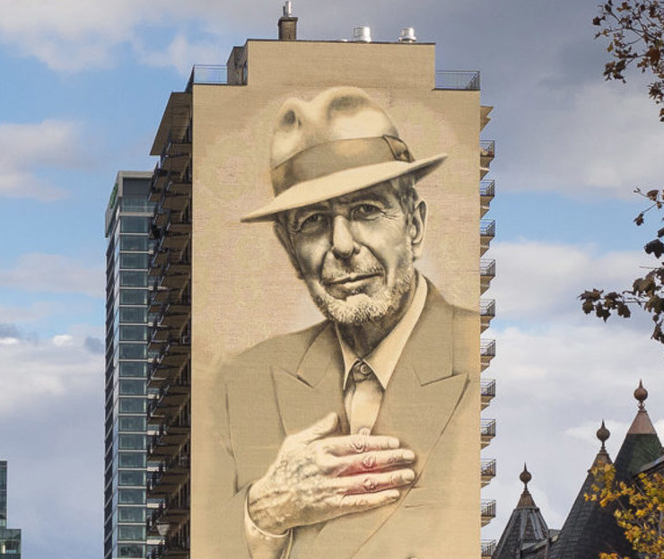 A 22-story tall portrait of Leonard Cohen on the side of a building on Montreal's Crescent Street.