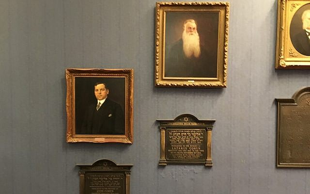 Portraits of Leonard Cohen's grandfather, Lyon Cohen, left, and great-grandfather, Lazarus Cohen, at Congregation Shaar Hashomayim. (Ben Harris/JTA)