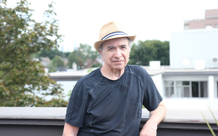 Michael Posner, author of 'Leonard Cohen, Untold Stories,' poses on the rooftop terrace of his apartment building in midtown Toronto, August 21, 2020. (Etye Sarner)