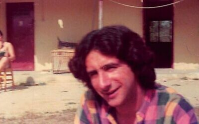 Robert Rotenberg as a volunteer on Kibbutz Hatzerim in the summer of 1976, where he spent two months picking oranges and working in a drip irrigation factory. (Courtesy)