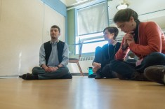 """Fifth-Year neuroscience major Mark Johnson leads a speed faithing discussion on Hinduism. """"[Interfaith dialogue] expands your own perspective of what human nature is like. On a more human level, on an emotional level, it helps you empathize,"""" Johnson said."""
