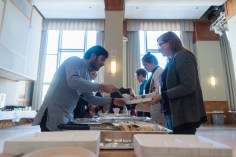 Center for Spirituality Dialogue, and Service student workers serve NEISS participants to lunch after speed faithing sessions on Friday, Feb. 9.