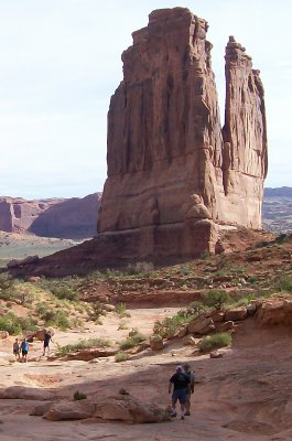 Hikers on arid mountainous trail