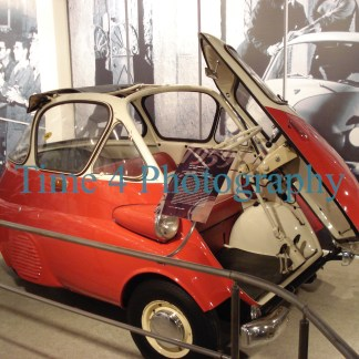 Red Romi Isetta bubble Car, with white roof top, front view at a car show