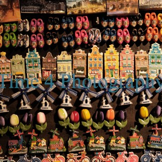 A big choice of typical small magnets,such as windmills, houses, wooden clogs, etc, sold for tourists at souvenir shops in Amsterdam.