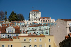 A cluster of typical houses in Lisbon,Portugal, in various colors and against a blue sky
