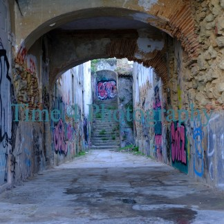 Old passage in Lisbon,Portugal. The walls are covered with Graffiti, and at the far end there are stairs also painted with Graffiti