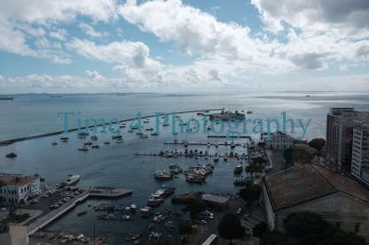 Aerial view of boats anchored at the bay of Salvador, Bahia, in Brasil. In the sky there are big white clouds