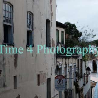 Old houses of the colonial period in Salvador da Bahia, Brazil. The paint is peeling off from the facades amidst dark blotches.