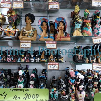 Traditional Brazilian dolls for sale in a market in Salvador da Baia, Brasil. Many different dolls, with their price tags