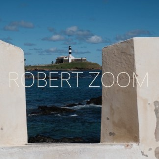 farol da Barra Lighthouse, in Salvador da Bahia, Brasil, seen from a turret and the blue sea in the foreground