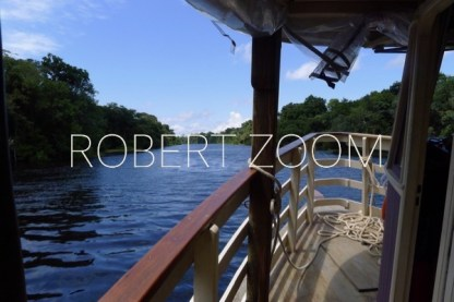 Rio Negro in Amzonas, Brazil, at the heart of the tropical rainforest, as seen from inside a boat navigating in its waters.