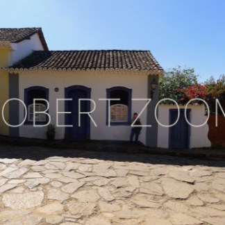 Typical house architecture of the colonial period in Tiradentes, Minas Gerais. The street pavement is made of stones.