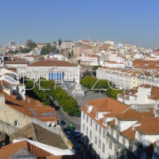 A glimpse on the sunbathed red rooftops of the lower part of Lisbon, as seen from inside the Sant Justa lift, also known as Elevador do Chiado
