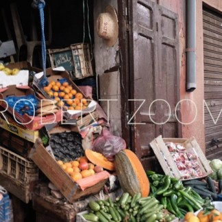 Inside the Medina of Marrakech in Morocco, a grocery store displays its products on the sidewalk