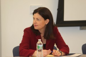 U.S. Sen. Kelly Ayotte, R-NH, listens to discussion by top NH officials on heroin/oxy addiction.