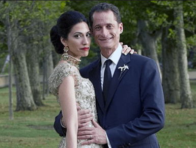 Hillary Clinton's longtime personal assistant Huma Abedin married Anthony Weiner in a ceremony officiated by Bill Clinton. /AP Photo