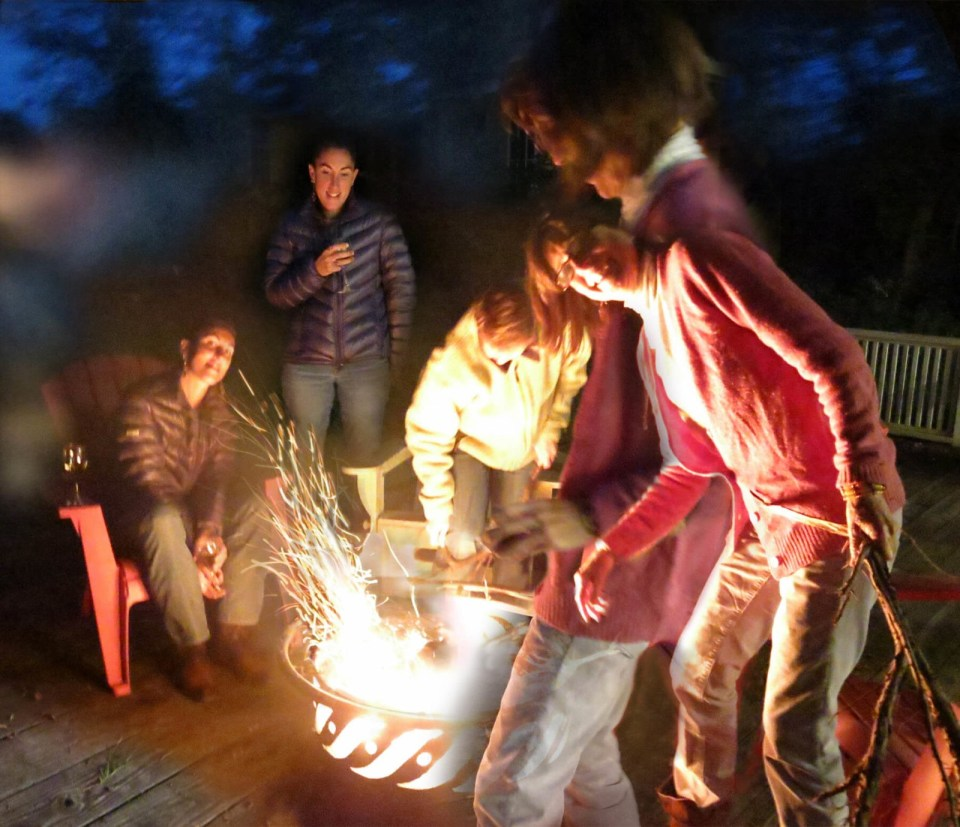 In Ithaca, New York, Robin Botie and fiends make a campfire on her deck.