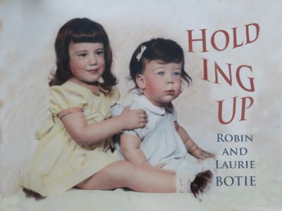 Robin Botie of Ithaca, New York, as a toddler holding up her younger sister, Laurie Botie.