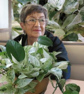 Mother of Robin Botie with dieffenbachia plant that is experiencing change and loss