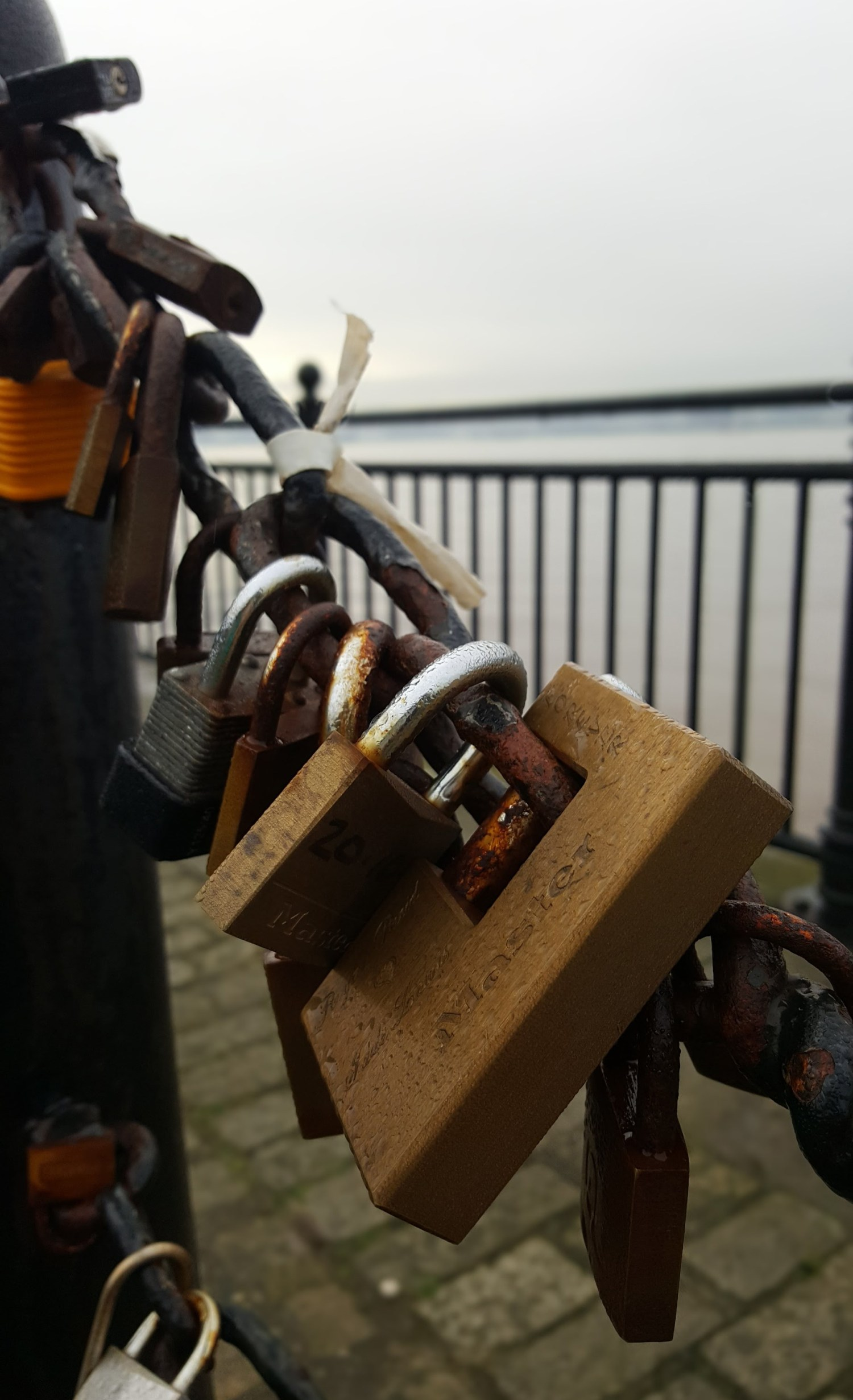 padlocks by the side of the Mersey in Liverpool