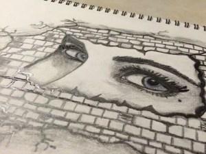 drawing of a woman's eyes behind a brick wall