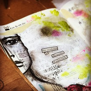 altered book page of a woman's face and a 'found word' story by RobinLK Studios