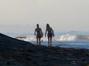 surfers head for the waves at Balian Beach, Bali, Indonesia