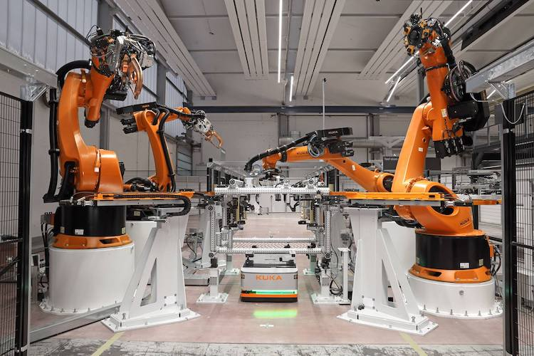 Kuka demonstrates 'flexible matrix production' system based on robotic work cells and automated guided vehicles