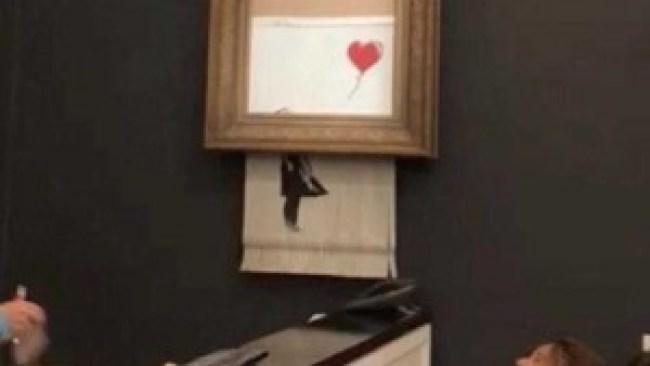 Het schilderij 'Meisje met de ballon' is net verkocht voor zo'n 1,2 miljoen euro als het zichzelf door de schredder haalt (foto Sotheby's)