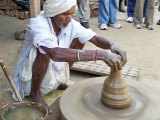 Nepal man makes drinking cups.