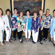 Ready to serve the new travel year: Joyce Frey, Phyllis Ayers, Gayle Coe, Bert Zeitlin, Peggy Crandell Duff, Pat Thompson, Jan Wallace, Susan Hebert and Vicki Baker