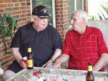 John O'Keefe and Dick Hodson enjoy each other's company.