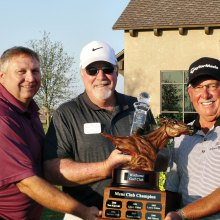 Jim McCracken, middle, is presented with the Championship Trophy by David Thatcher, the Club Head Professional, left, and Lawry Cohen, last year's Club Champion on the right.