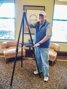 Ron Ice, club president, setting up easels