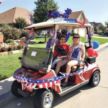 Joyce Sjerven and Tinka Levis of the Singles Club won first place for their patriotic cart decoration at the community Fourth of July parade.
